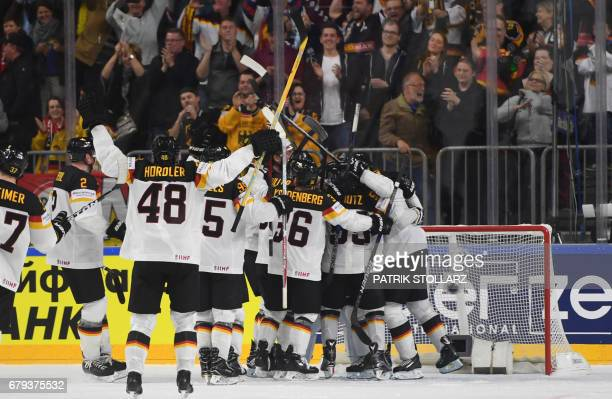 Germany´s players celebrate during the IIHF Ice hockey world championship first round match between USA and Germany in the LANXESS arena in Cologne...