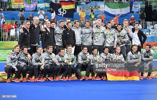 Germany's players celebrate on the podium with their bronze medals during the men's field hockey medals ceremony of the Rio 2016 Olympics Games at...