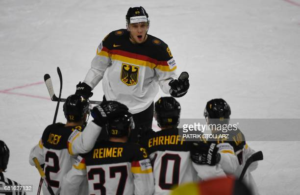 Germany´s players celebrate scoring during the IIHF Ice Hockey World Championships first round match between Slovakia and Germany in Cologne western...
