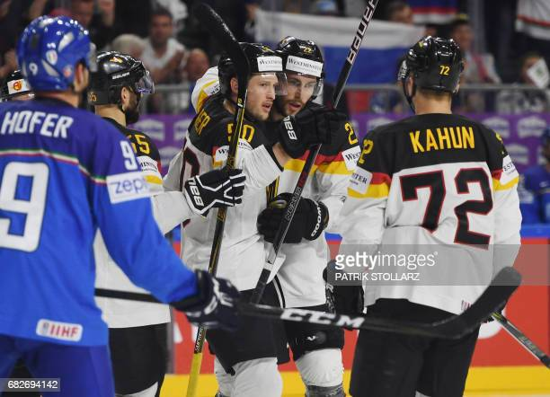 Germany´s players celebrate scoring during the IIHF Ice Hockey World Championships first round match between Italy and Germany in Cologne western...