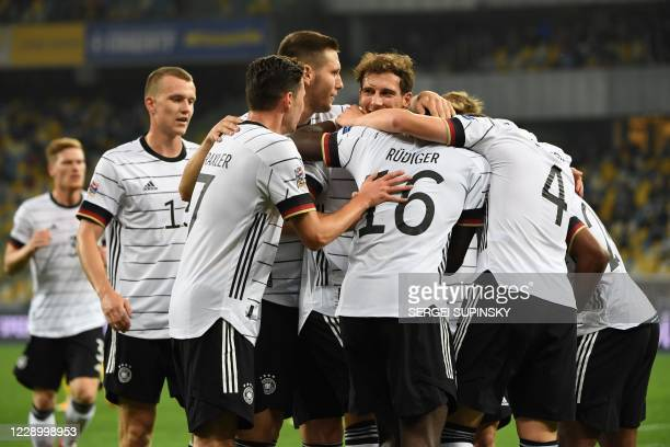 Germany's players celebrate the opening goal scored by Germany's defender Matthias Ginter during the UEFA Nations League football match between...