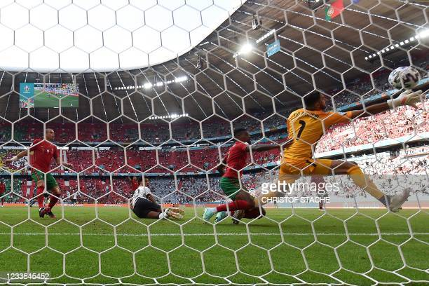 Germany's players celebrate their first goal, an own goal by Portugal's defender Ruben Dias during the UEFA EURO 2020 Group F football match between...