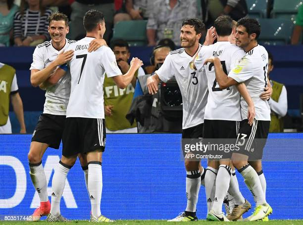 Germany's players celebrate their fourth goal during the 2017 FIFA Confederations Cup semifinal football match between Germany and Mexico at the...