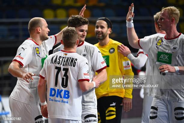 Germany's players celebrate their victory at the end of the 2021 World Men's Handball Championship between Group A teams Germany and Uruguay at the...