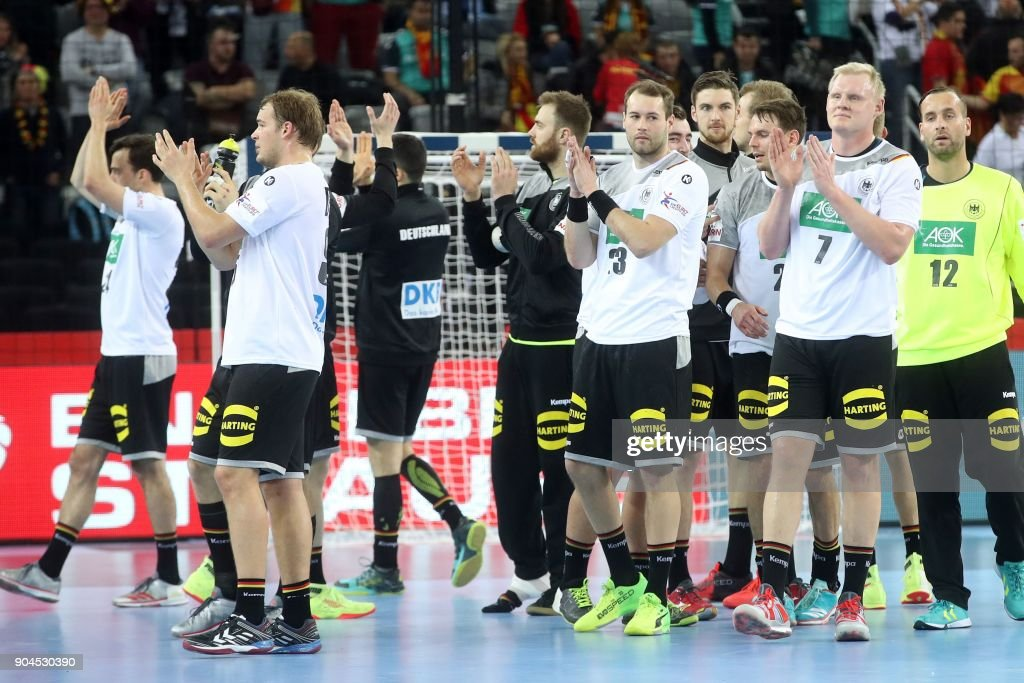 Germany's players celebrate their victory at the end of the preliminary round group C match of the Men's 2018 EHF European Handball Championship between Germany and Montenegro in Zagreb on January 13, 2018. /