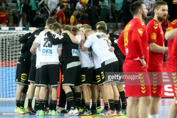 Germany's players celebrate their victory at the end of the preliminary round group C match of the Men's 2018 EHF European Handball Championship...
