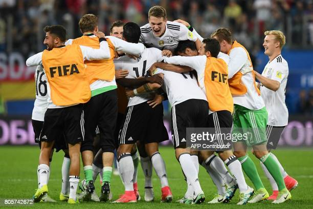 TOPSHOT Germany's players celebrate winning the 2017 Confederations Cup final football match between Chile and Germany at the Saint Petersburg...