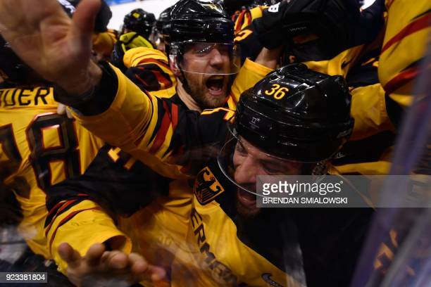 TOPSHOT Germany's players celebrate winning the men's semifinal ice hockey match between Canada and Germany during the Pyeongchang 2018 Winter...