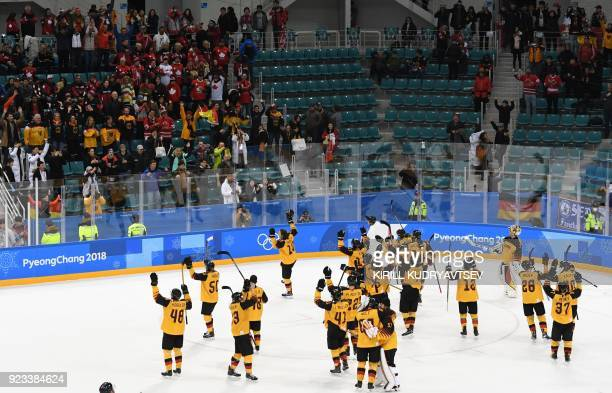 Germany's players celebrate winning the men's semifinal ice hockey match between Canada and Germany during the Pyeongchang 2018 Winter Olympic Games...