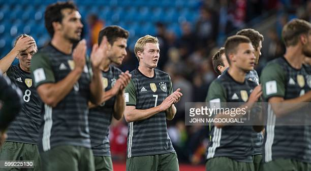 Germany's players celebrate with fans after the World Cup 2018 football qualification match between Norway and Germany in Oslo on September 4 2016 /...