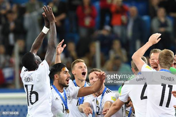 Germany's players celebrate with the trophy after winning the 2017 Confederations Cup final football match between Chile and Germany at the Saint...