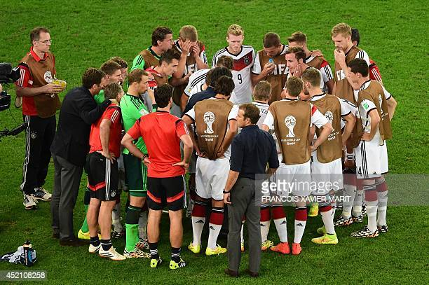 Germany's players gather ahead of extra time during the final football match between Germany and Argentina for the FIFA World Cup at The Maracana...