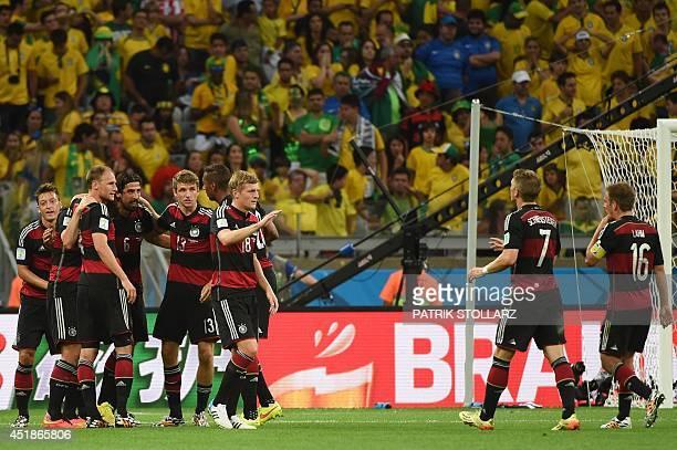 Germany's players including Germany's midfielder Sami Khedira Germany's forward Thomas Mueller Germany's midfielder Toni Kroos Germany's midfielder...