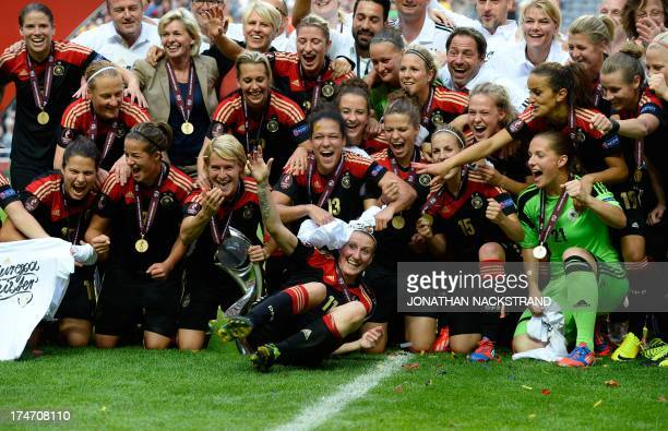 Germany's players including goal scorer Anja Mittag celebrate with the trophy after winning the UEFA Women's European Championship Euro 2013 final...