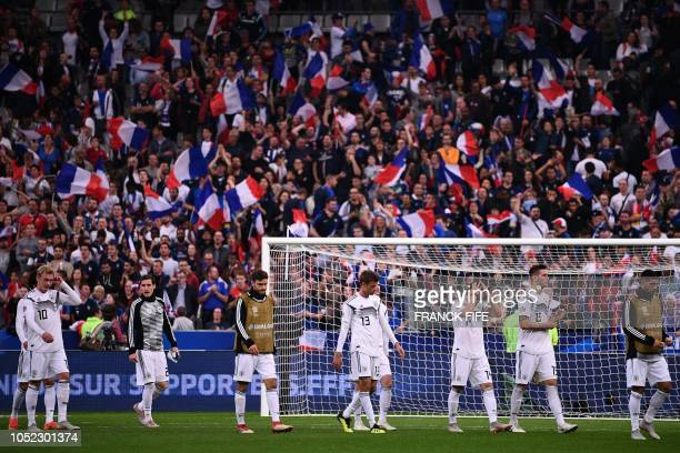 Germany's players leave the pitch after being defeated by France at the end of the UEFA Nations League football match between France and Germany at...