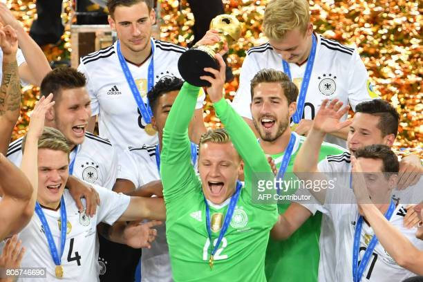 Germany's players lift the trophy after winning the 2017 Confederations Cup final football match between Chile and Germany at the Saint Petersburg...