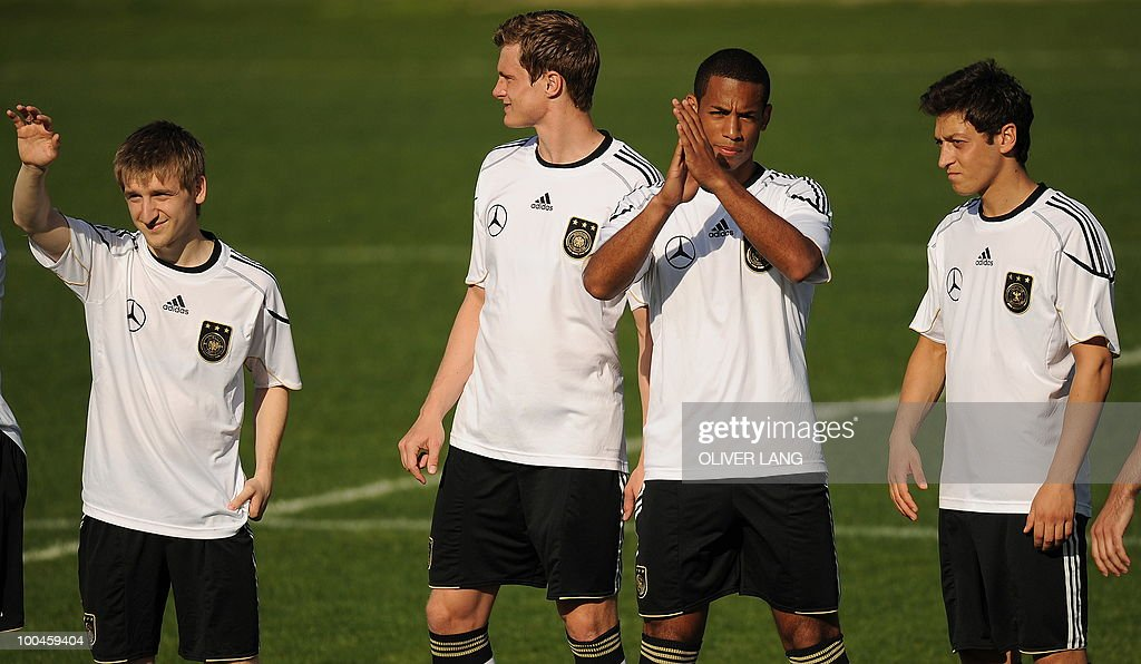 Germany's players (L-R) midfielder Marko Marin, defender Marcell Jansen, defender Dennis Aogo and midfielder Mesut Oezil wave after a training match Germany vs Sued Tyrol FC at the team's training centre in Appiano, near the north Italian city of Bolzano May 24, 2010. The German football team is currently taking part in a 12-day training camp in Appiano to prepare for the upcoming FIFA Football World Cup in South Africa.