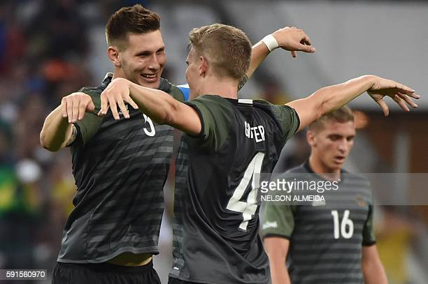 Germany's players Niklas Suele and Matthias Ginter celebrate their 20 victory over Nigeria at the end of their Rio 2016 Olympic Games mens semifinal...
