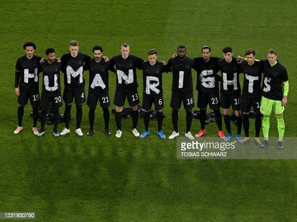 "Germany's players pose for a group photo with the wording ""Human rights"" on their T-shirts prior to the FIFA World Cup Qatar 2022 qualification..."
