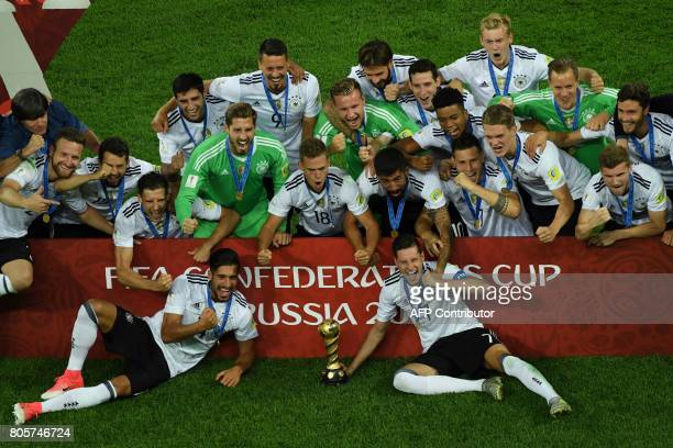 Germany's players pose with the trophy after winning the 2017 Confederations Cup final football match between Chile and Germany at the Saint...