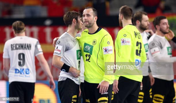 Germany's Uwe Gensheimer and Silvio Heinevetter react after their team's defeat in the group II match of the Men's 2018 EHF European Handball...