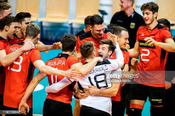 Germany's players react at matchpoint after defeating Belgium's team during the pool A Men's CEV Tokyo Volleyball European Qualification 2020 match...