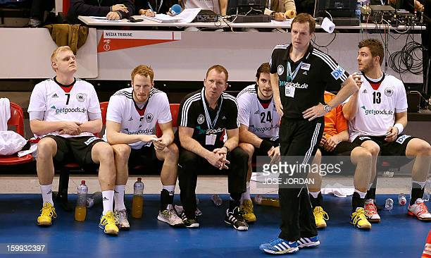 Germany's players react during the 23rd Men's Handball World Championships quarterfinal match Spain vs Germany at the Pabellon Principe Felipe in...