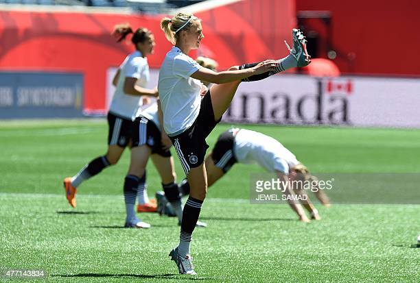 Germany's players stretch during a training session at the Winnipeg Stadium, in Winnipeg, Manitoba on June 14, 2015 on the eve of their Group B...