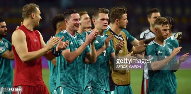 Germany's players thank supporters after the Euro 2020 football qualification match between Belarus and Germany in Borisov outside Minsk on June 8...