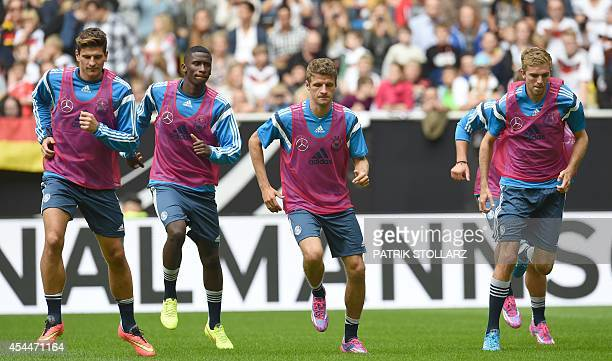 Germany´s players warm up during a training session of the German national football team in Duesseldorf Germany on September 1 2014 Germany's squad...