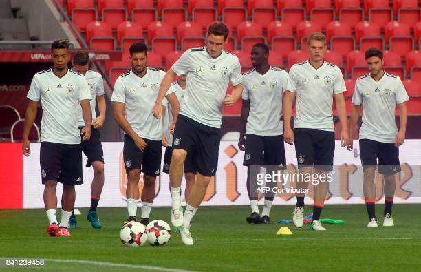 Germany's players warm up during a training session on August 31 2017 at the Eden Arena in Prague on the eve of their FIFA World Cup 2018 Group C...