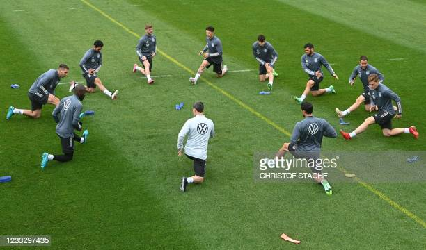 Germany's players warm up during a training session on June 6 in Seefeld, Austria, where the German national football team attends a training camp...