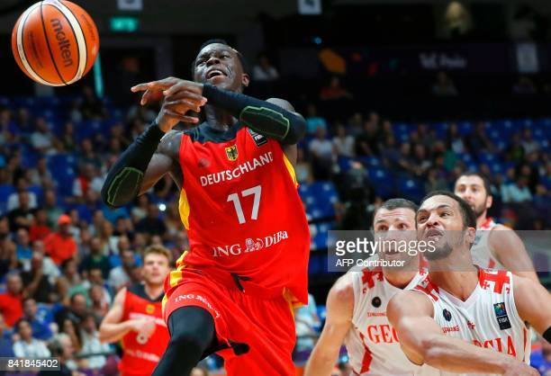 Germany's point guard Dennis Schroder attempts a shot past Georgia's guard Michael Dixon Jr during their FIBA EuroBasket 2017 basketball championship...