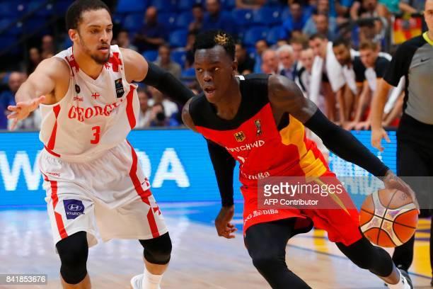 Germany's point guard Dennis Schroder dribbles the ball past Georgia's guard Michael Dixon Jr during their FIBA EuroBasket 2017 basketball...