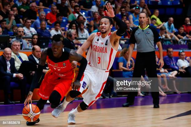 Germany's point guard Dennis Schroder dribbles the ball past Georgia's guard Michael Dixon Jr during their FIBA EuroBasket 2017 basketball...