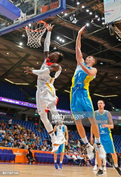 Germany's point guard Dennis Schroder drives to the basket as he is marked by Ukraine's small forward Oleksandr Lypovyy during the FIBA EuroBasket...