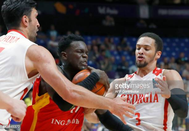 Germany's point guard Dennis Schroder vies for the ball with Georgia's guard Michael Dixon Jr and centre Zaza Pachulia during their FIBA EuroBasket...