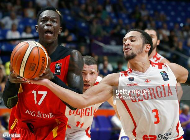 Germany's point guard Dennis Schroder vies for the ball with Georgia's guard Michael Dixon Jr during their FIBA EuroBasket 2017 basketball...