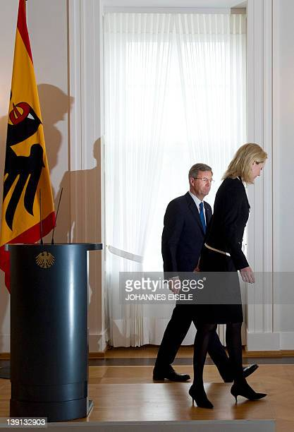 Germany's president Christian Wulff and his wife Bettina leave the room after he gave a statement to annouce he resigns on February 17 2012 at the...