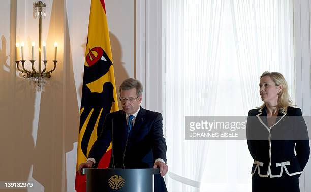 Germany's president Christian Wulff speaks next to his wife Bettina as he gives a statement to announce he resigns on February 17 2012 at the...