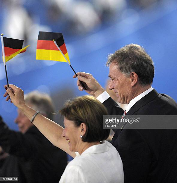 Germany's President Horst Kohler waves the national flag to his delegation during the opening ceremony for the 2008 Beijing Paralympic Games at the...