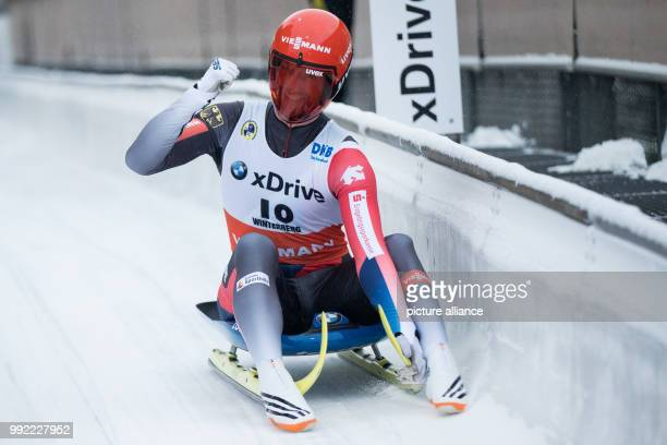 Germany's RalkPalik celebrates during the Men's Singles race event of the Luge World Cup in Winterberg, Germany, 26 November 2017. Photo: Marcel...