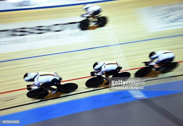 Germany's riders compete in the women's Team Pursuit at the UCI Track Cycling World Championships in Apeldoorn on March 1 2018 / AFP PHOTO / EMMANUEL...