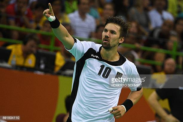 Germany's right wing Fabian Wiede celebrates a goal during the men's quarterfinal handball match Germany vs Qatar for the Rio 2016 Olympics Games at...