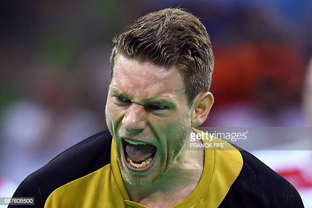 Germany's right wing Tobias Reichmann celebrates a goal during the men's preliminary round Group B handball match between Germany and Poland during...