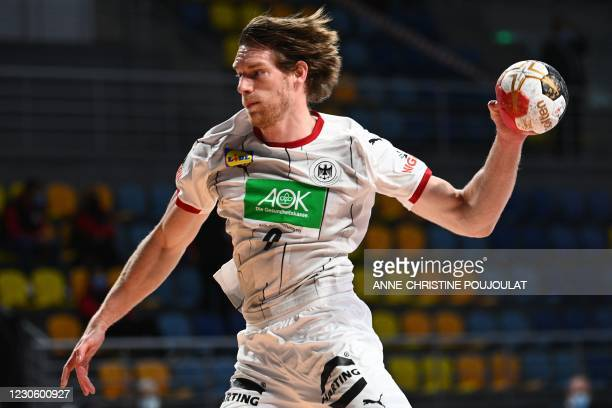 Germany's right winger Tobias Reichmann jumps to shoot during the 2021 World Men's Handball Championship between Group A teams Germany and Uruguay at...