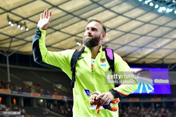 Germany's Robert Harting waves after the men's Discus Throw final during the European Athletics Championships at the Olympic stadium in Berlin on...
