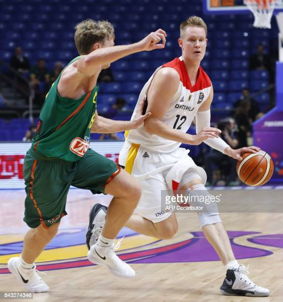 Germany's Robin Benzing plays against with Lithuania's Mindaugas Kuzminskas during the FIBA EuroBasket 2017 championship match between Germany and...