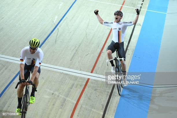 Germany's Roger Kluge and Germany's Theo Reinhardt celebrate winning the men's madison final during the UCI Track Cycling World Championships in...
