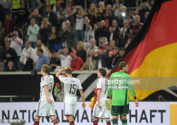 Germany's Roman Weidenfeller and his teammates walk off the pitch after the international match between Germany vs Argentina at Esprit arena in...